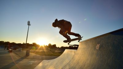 Image: A man skateboarding on a ramp in South Africa at sunset