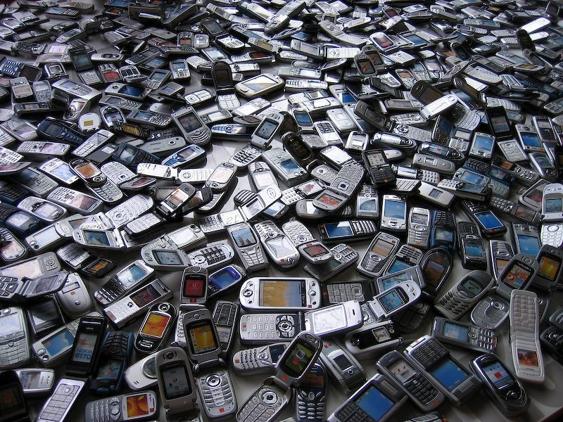 Image: a pile of old cell phones--will the new generation of them decrease the amount of e-waste we have?