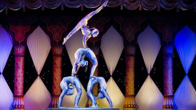 Image: Acrobats stacked in a triangle formation