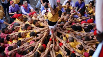Image: People coming together to create a human tower