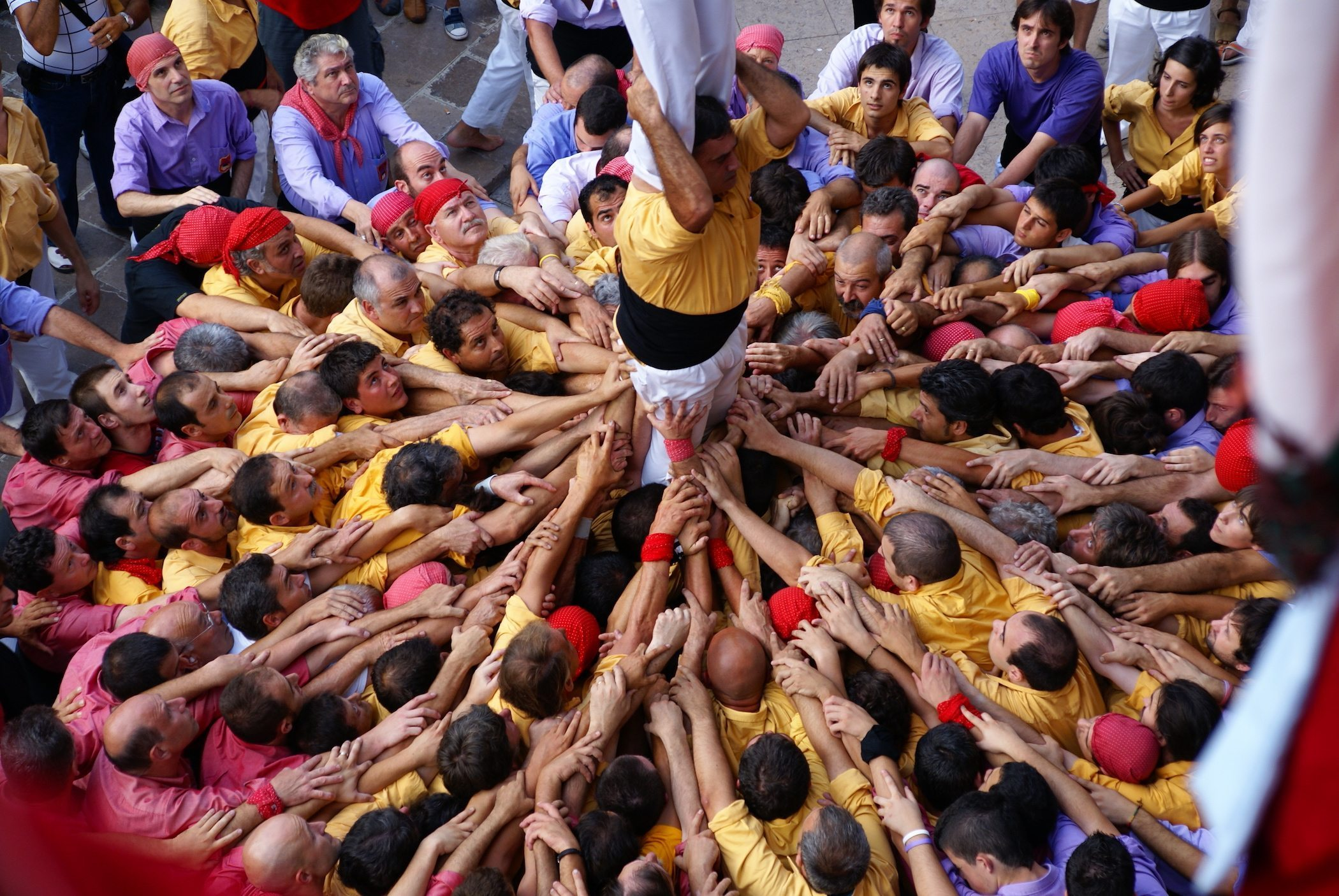 Image: People working together to create a human tower