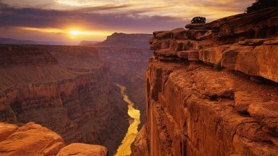 Image: Grand Canyon with sun rising over the river--an image from an article exploring the good news story of an organization that takes kids rafting down the Colorado river