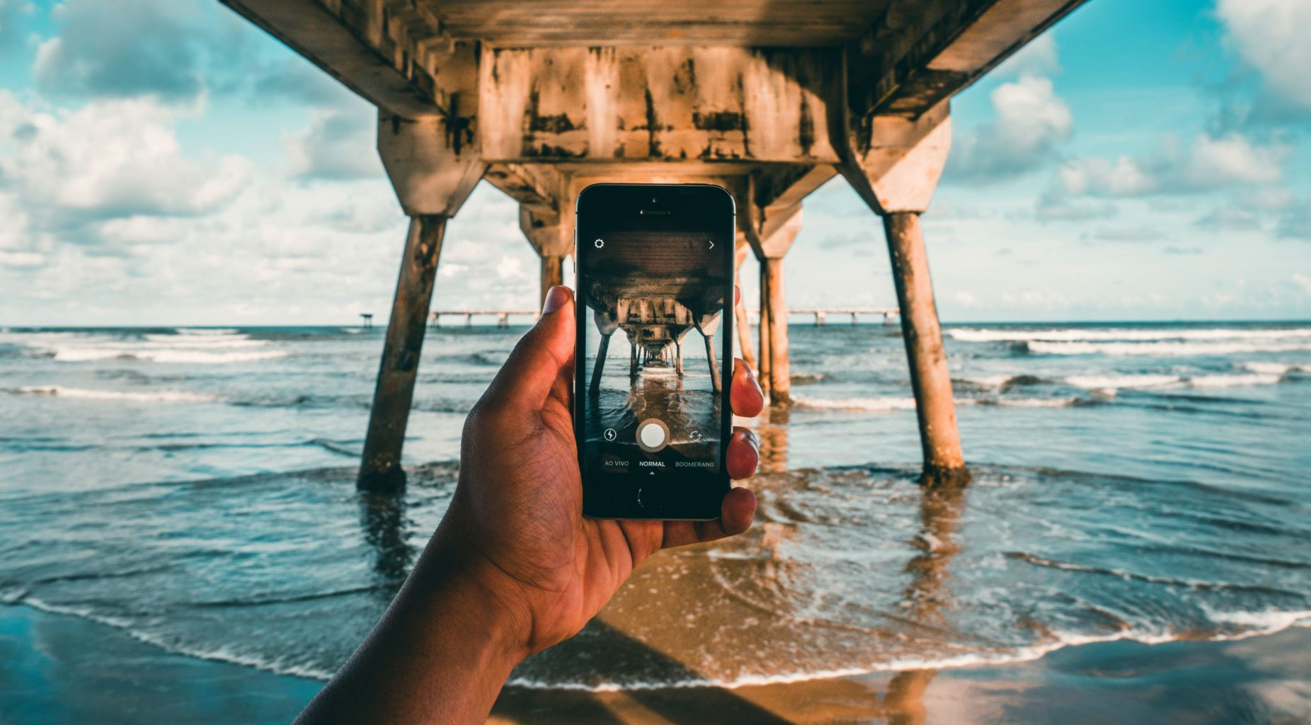 Image: An image within an image. A person taking a photo with an iphone