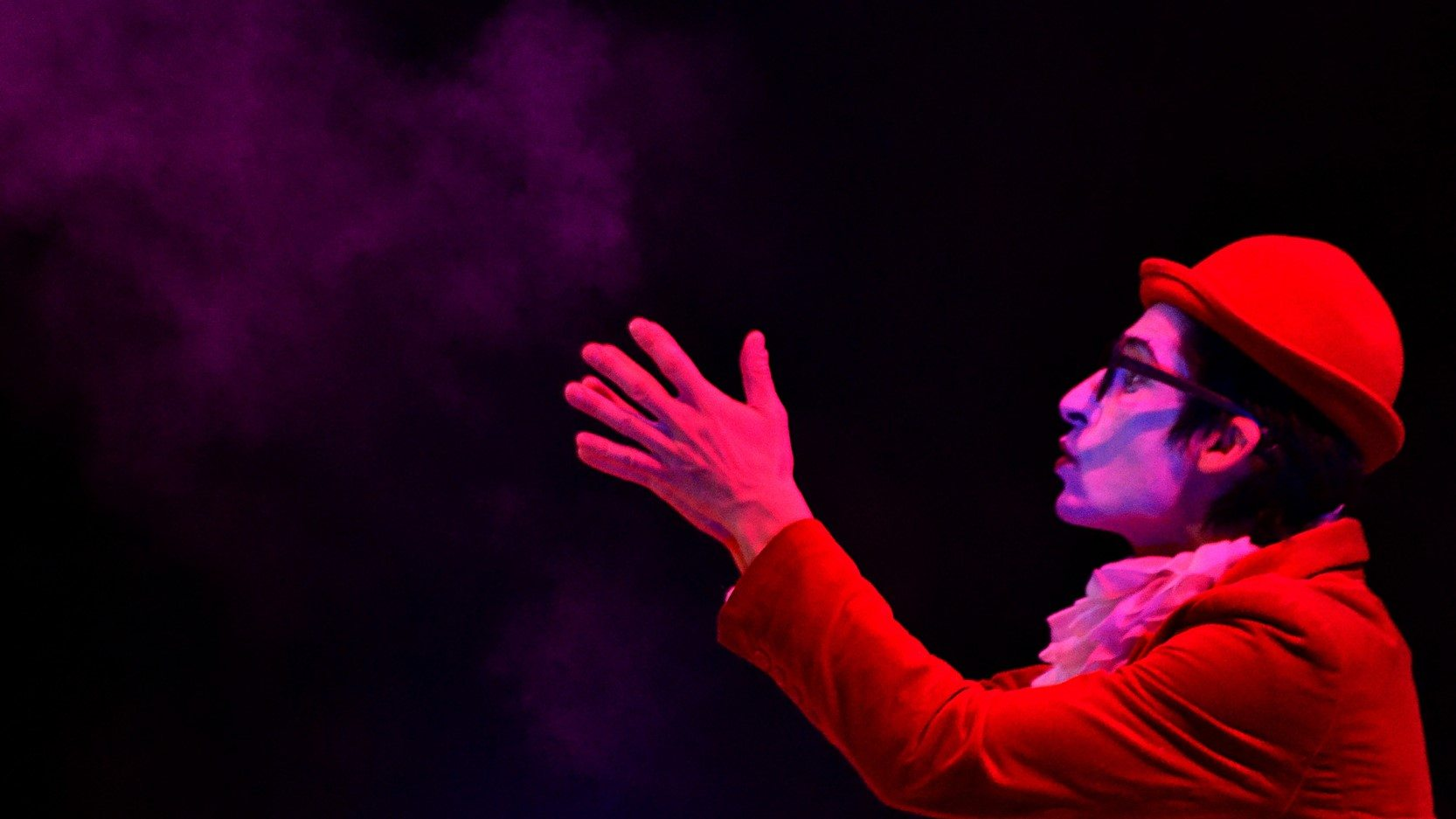 Image: Feeling of magic as a performer blows dust into the air.
