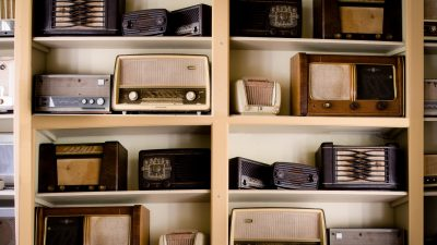 Image: Eclectic vintage radios lining the shelves of a shop