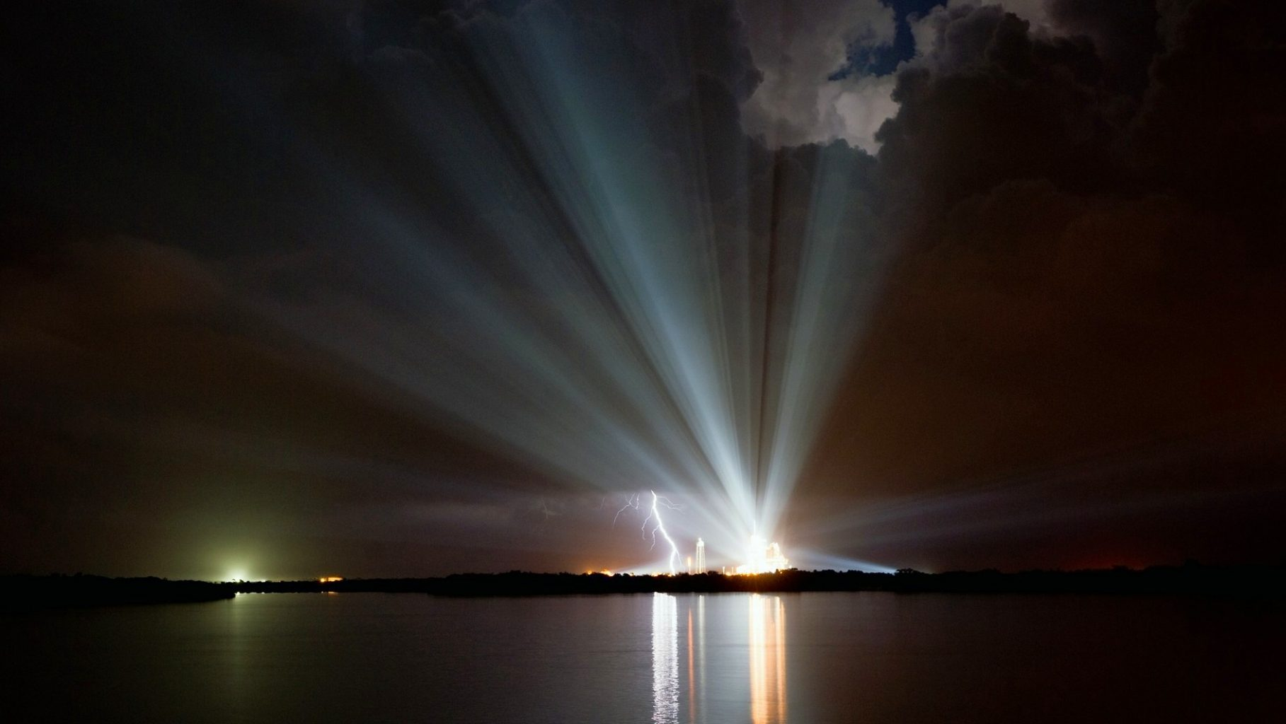 Image: A night time view of the lights radiating outward from the space shuttle launch