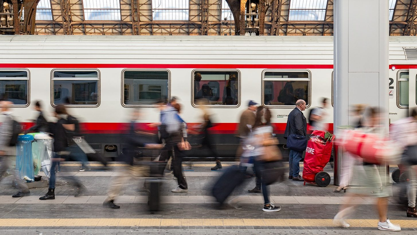 Image: people walking on a busy train platform