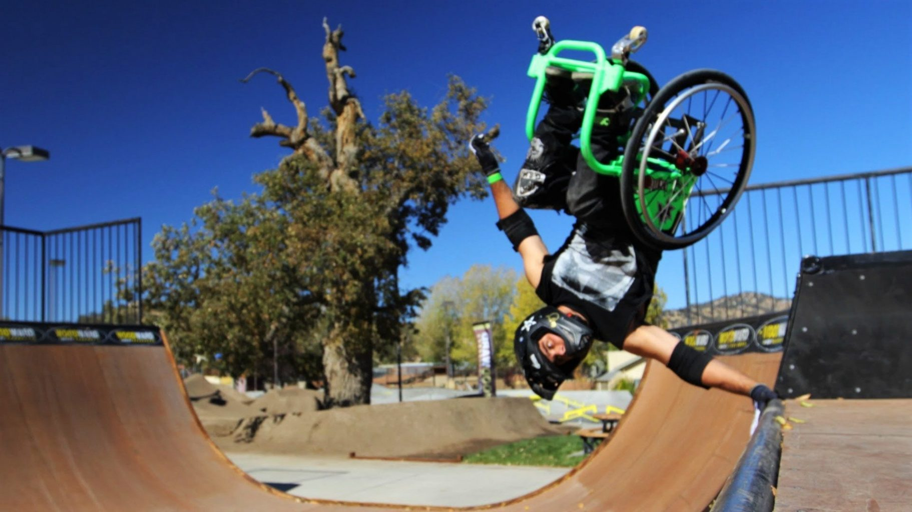 Image: Aaron Fotheringham, the founder of wheelchair motor-cross, in his wheelchair hand planting on rail.