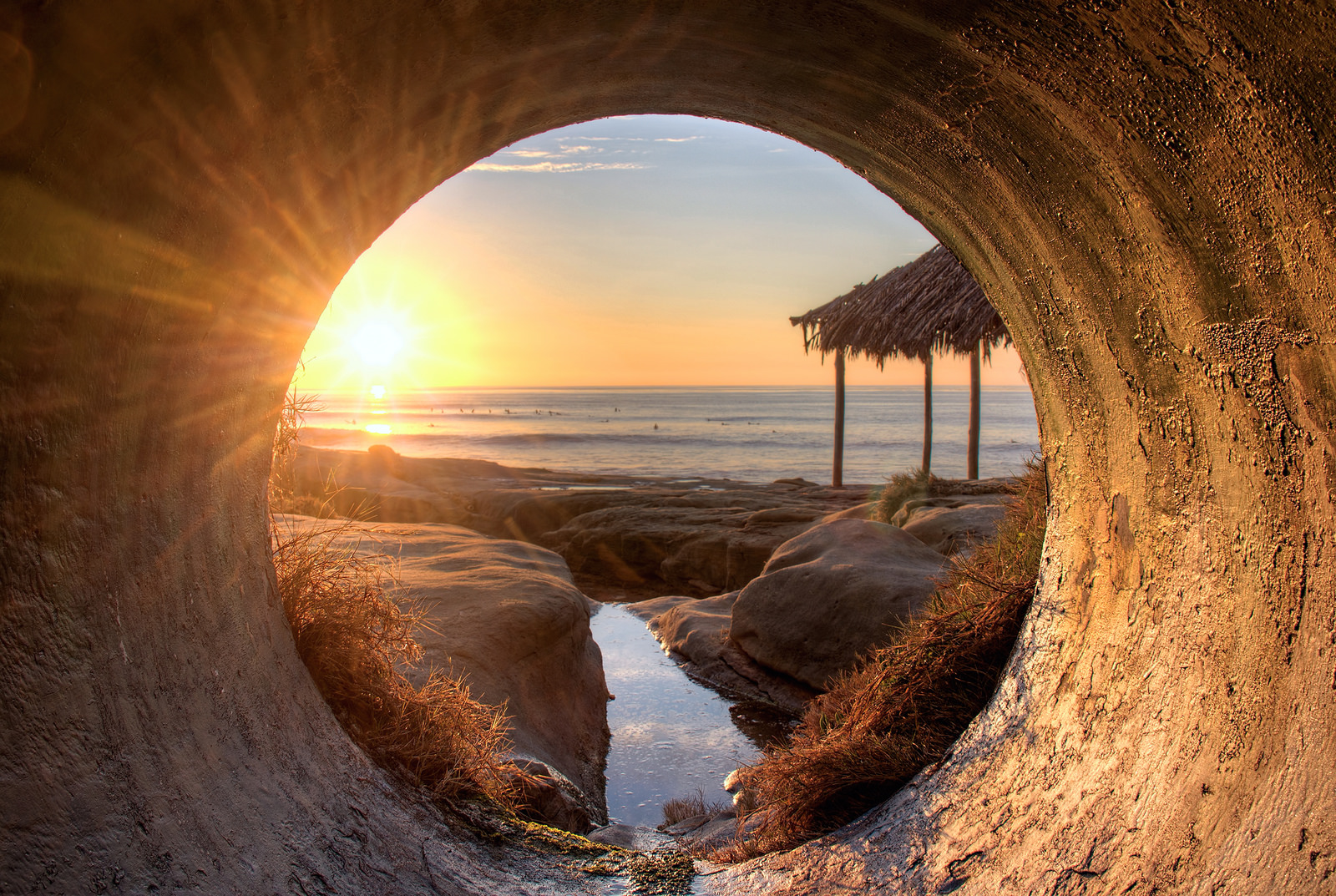Image: Looking out at the sunset from a sewer tunnel