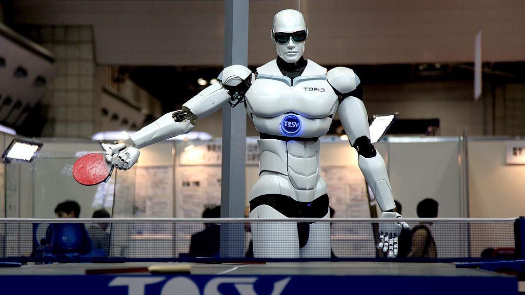 Image: A humanoid robot playing ping pong