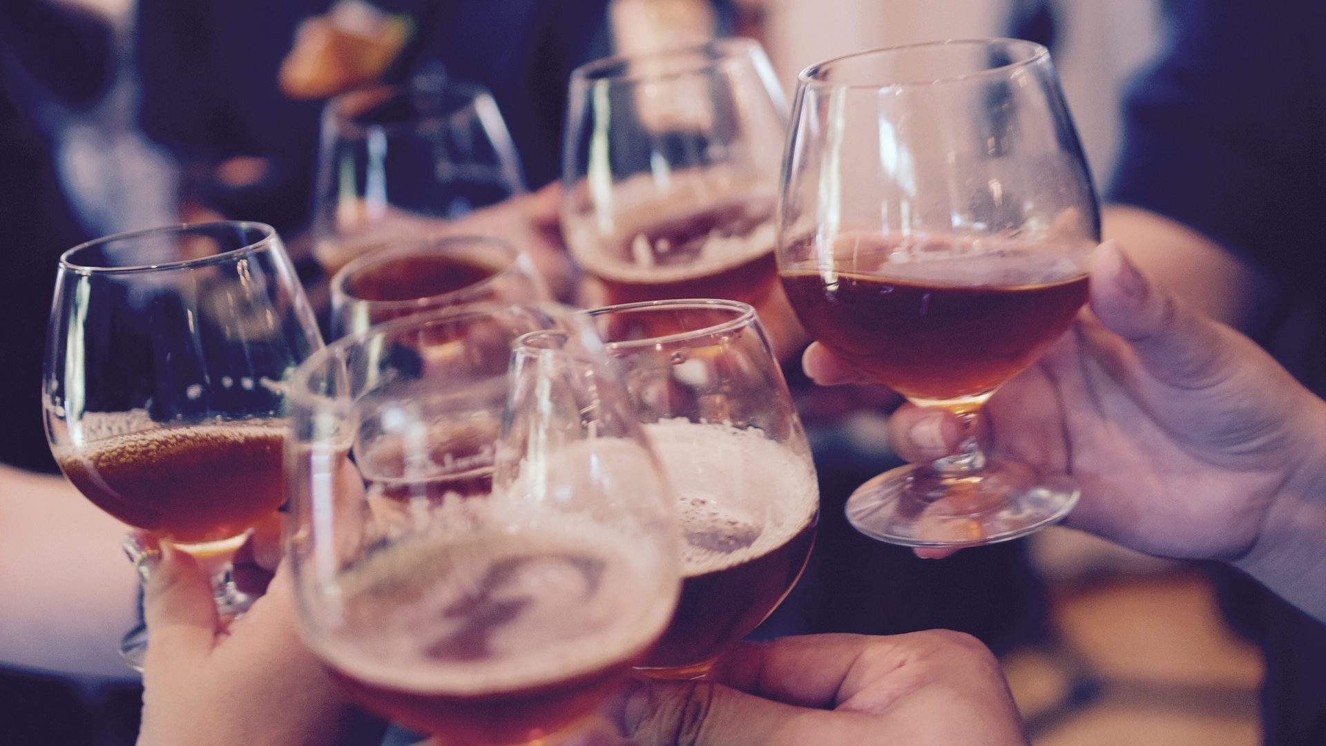 Image: Group toasting with beer glasses