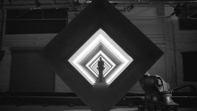 Image: Screen Capture from Box by Bot and Dolly of Person walking into geometric shapes