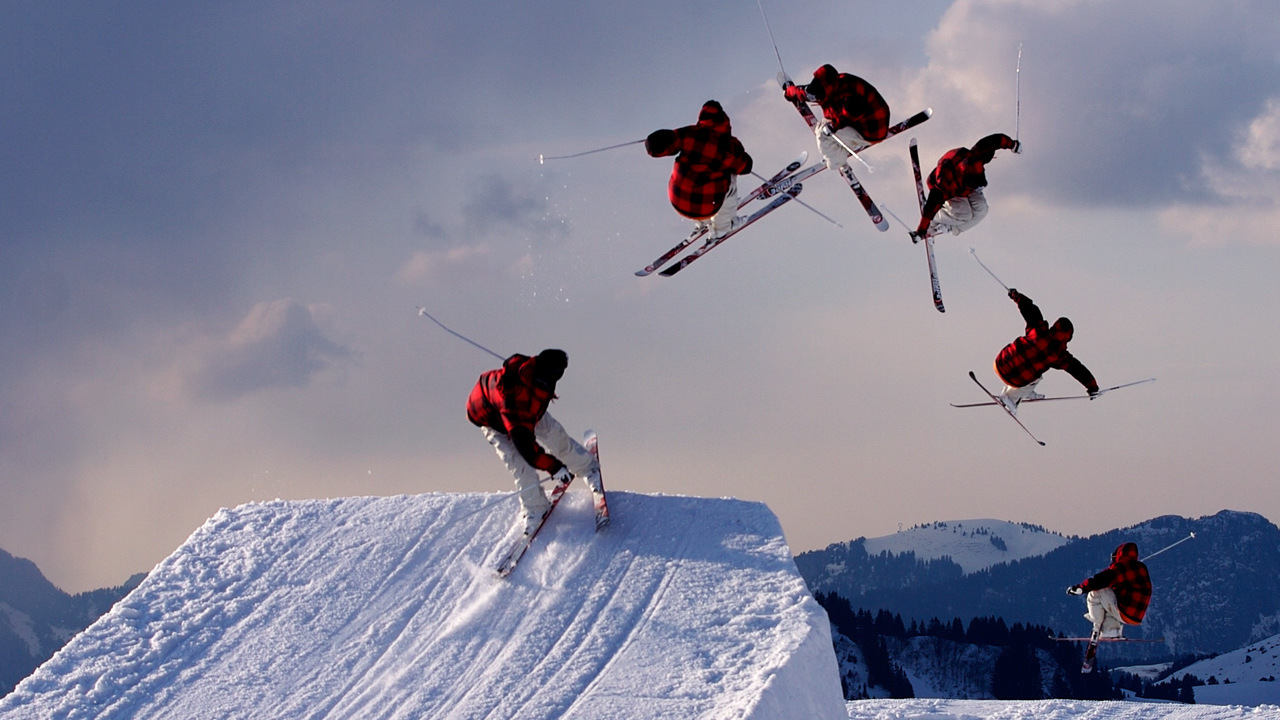 Image: A skier spinning through the air off a jump