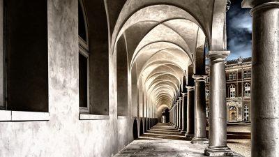 Image: View down long pillared hallway.
