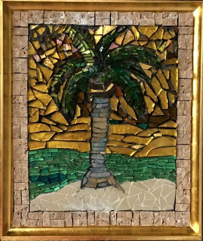 Image: Mosaic of a palm tree on a beach created by Suska Matsik