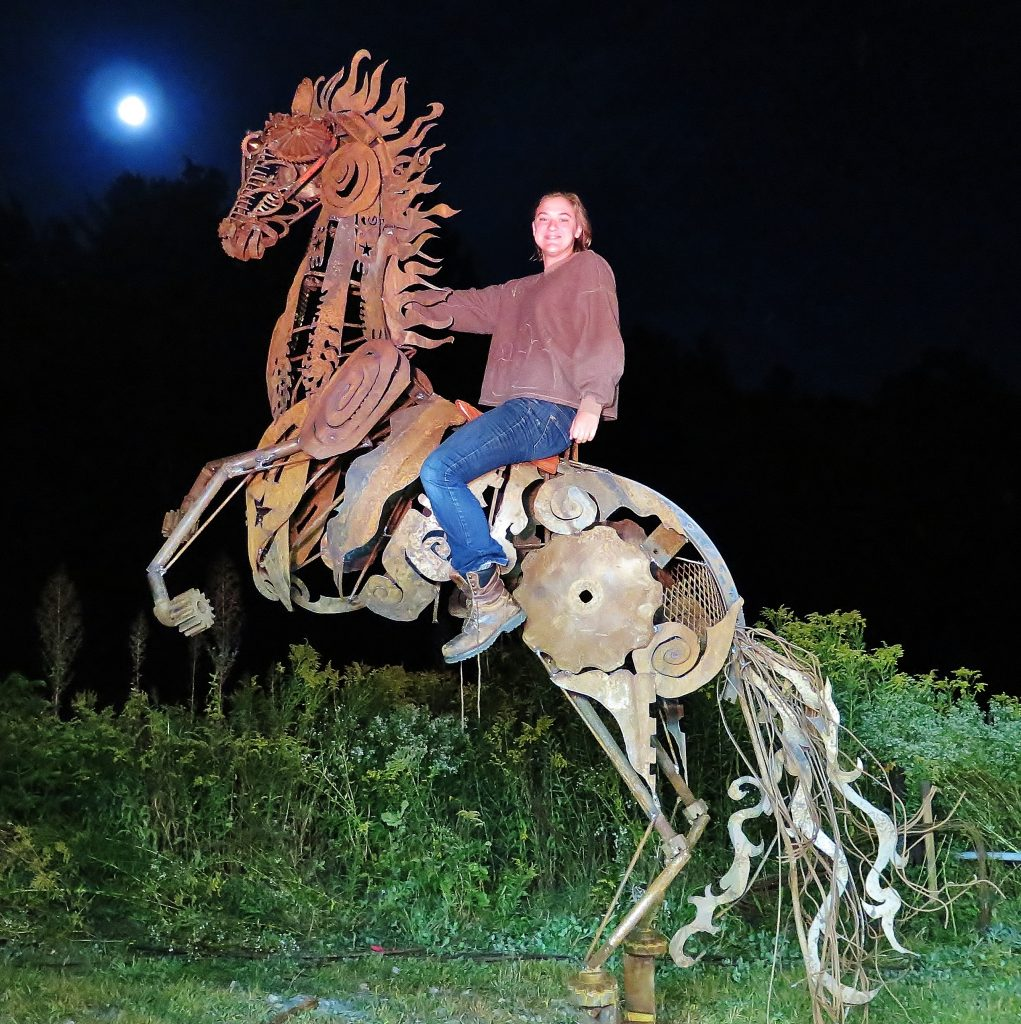 Louisa on her horse sculpture.