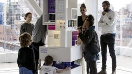 Image: People looking at the MICRO Smallest Mollusk Museum