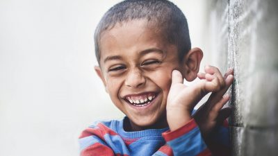 Image: Boy in a striped shirt smiling