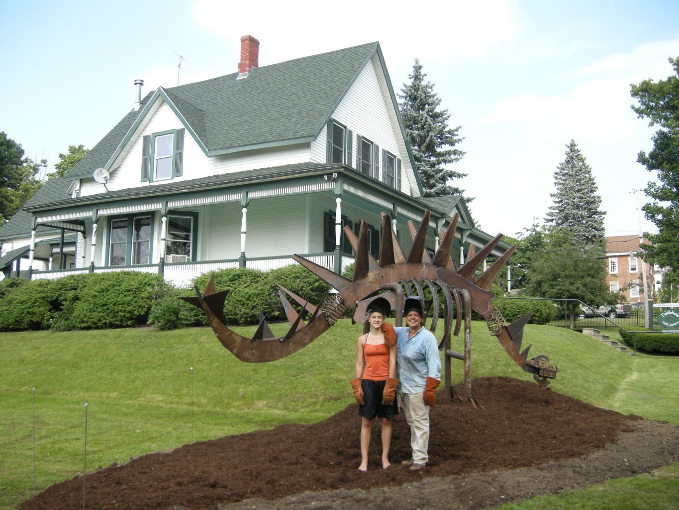 Image: Louisa and Lynda next to their sculpture of a dinosaur