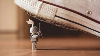 Image: Lego knight fighting off a shoe