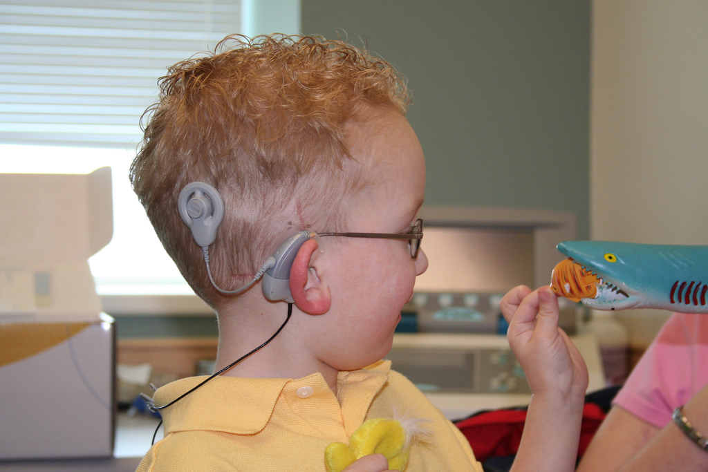 Image: Hearing impaired boy wearing cochlear implant