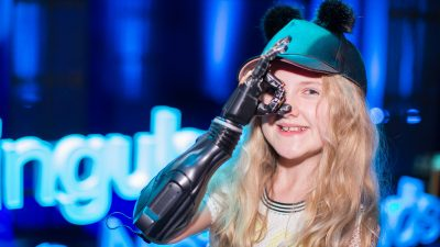 Image: Tilly Lockey at the SingularityU The Netherlands Summit in 2016 with her bionic arm
