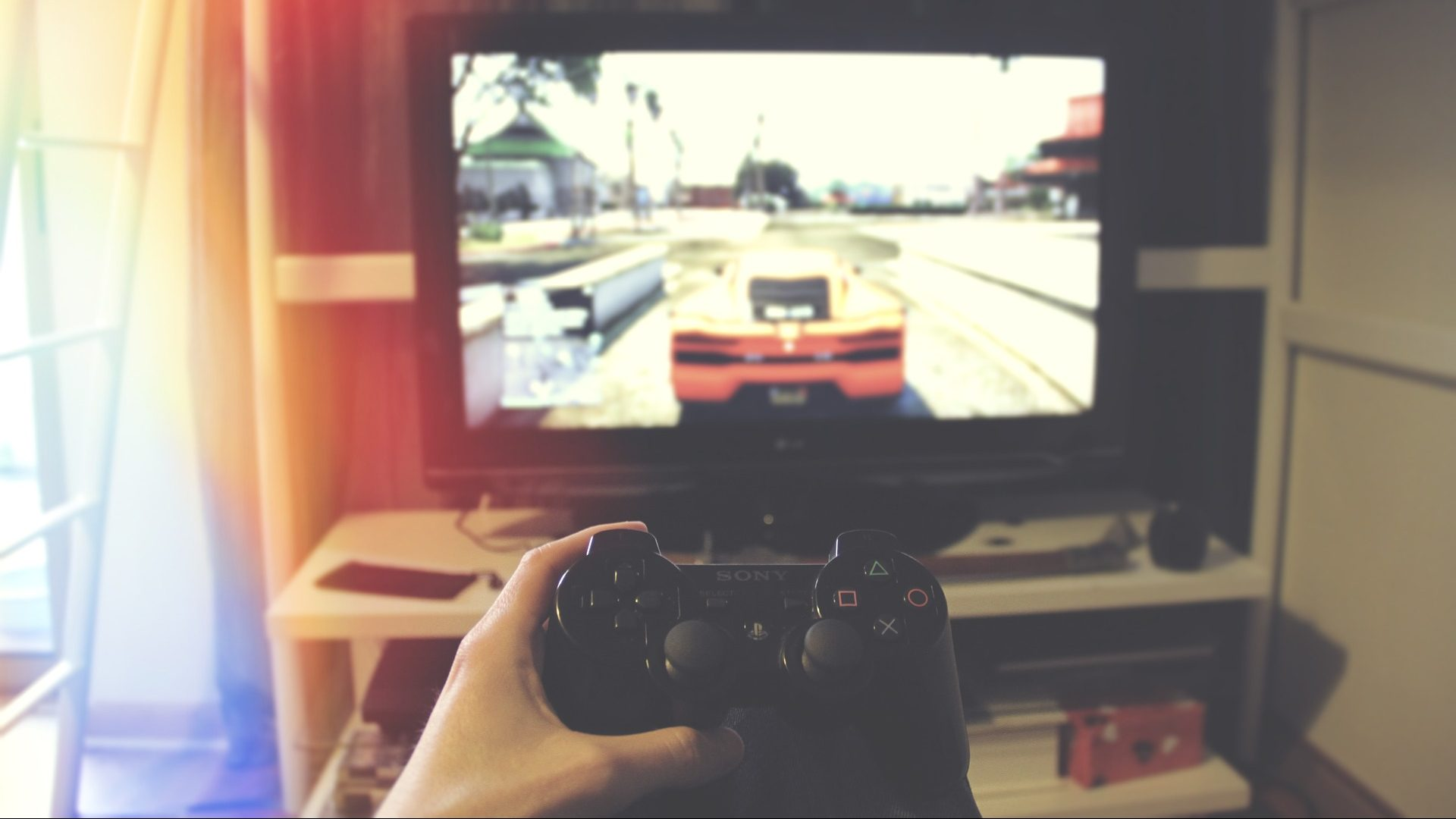 Image: Person playing a video game. Are video games bad for you?