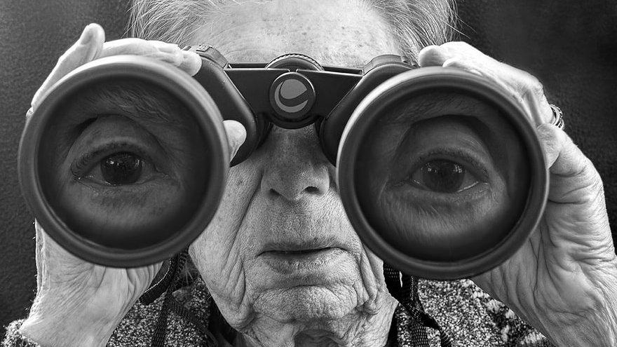 Image: Grandmother looking through binoculars
