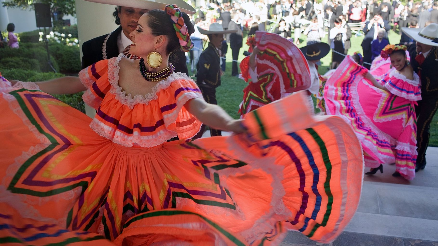 Image: Cinco Dancers with a beautiful, flowing gown