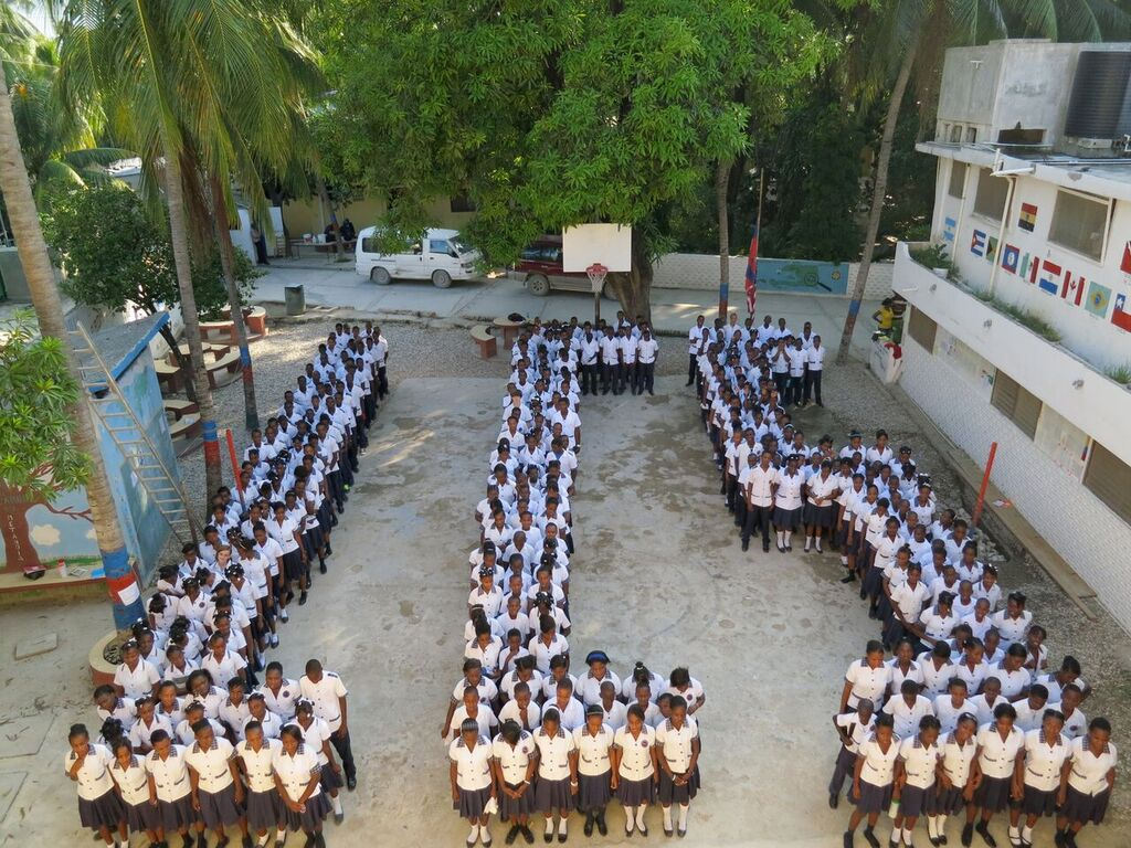Image: Hundreds of Students line up to form the letters LCS