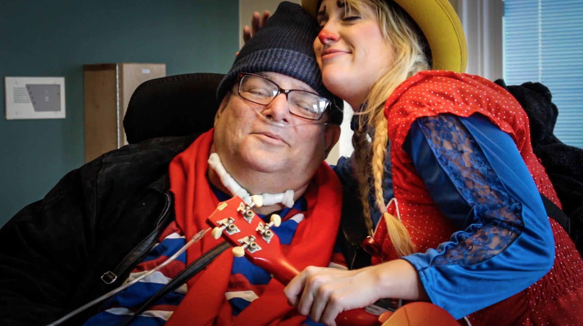 Image: Medical Clown hugging a patient