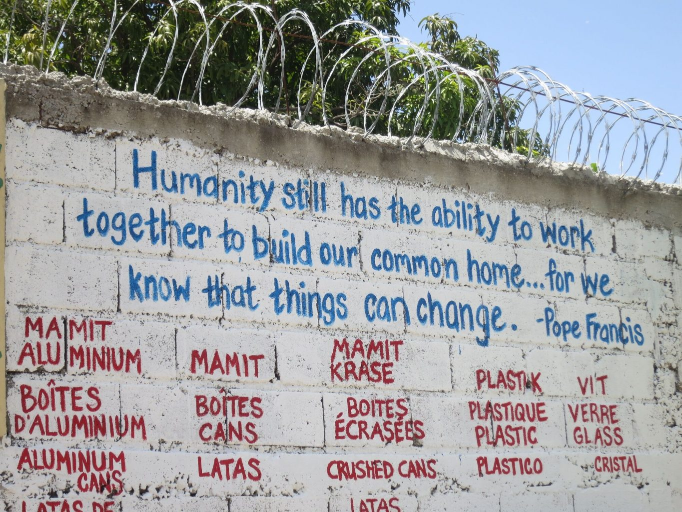 Image: A school wall at the Haitian Project with a wonderful saying on it!