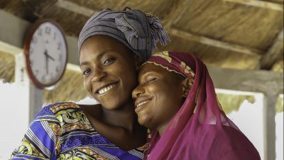 Image: Two women smiling and embracing