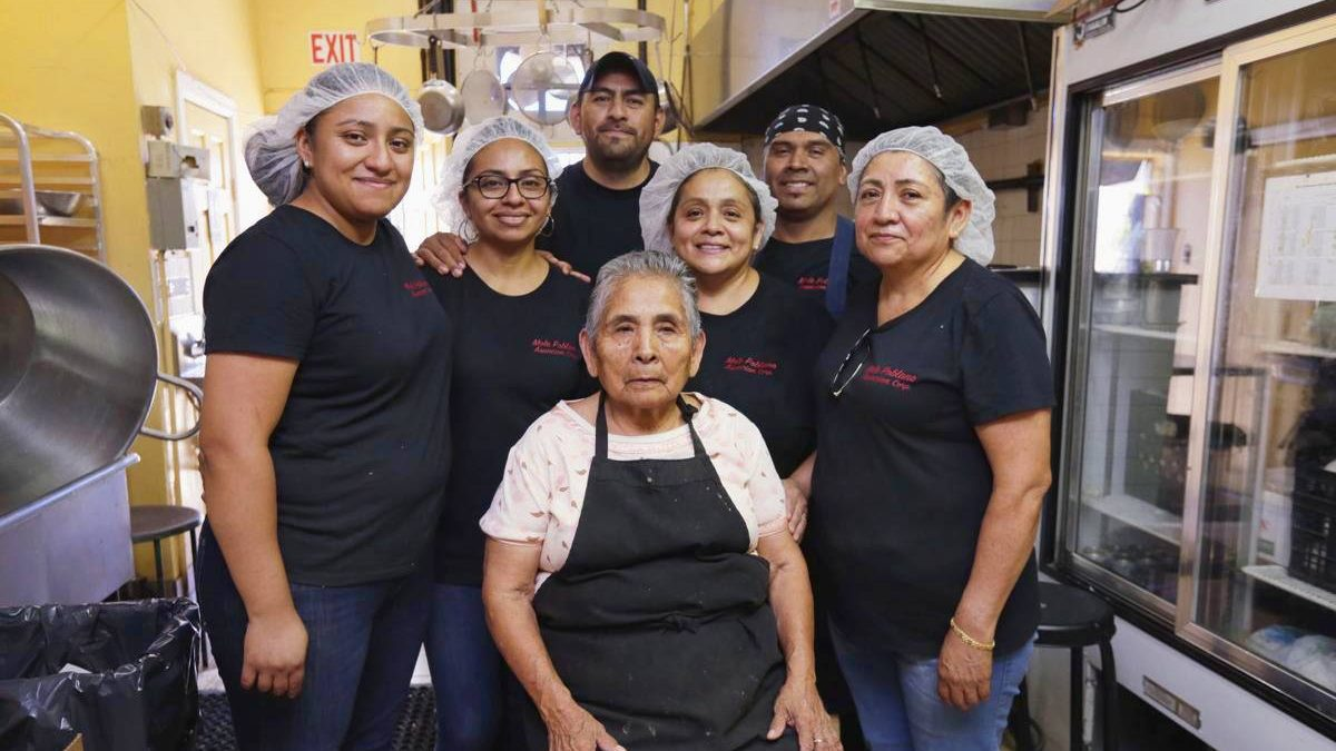 Image: the Mole Poblano Asuncion family together in their kitchen