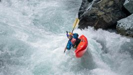 Image: Nouria Newman Kayaking though a large rapid in Ladakh