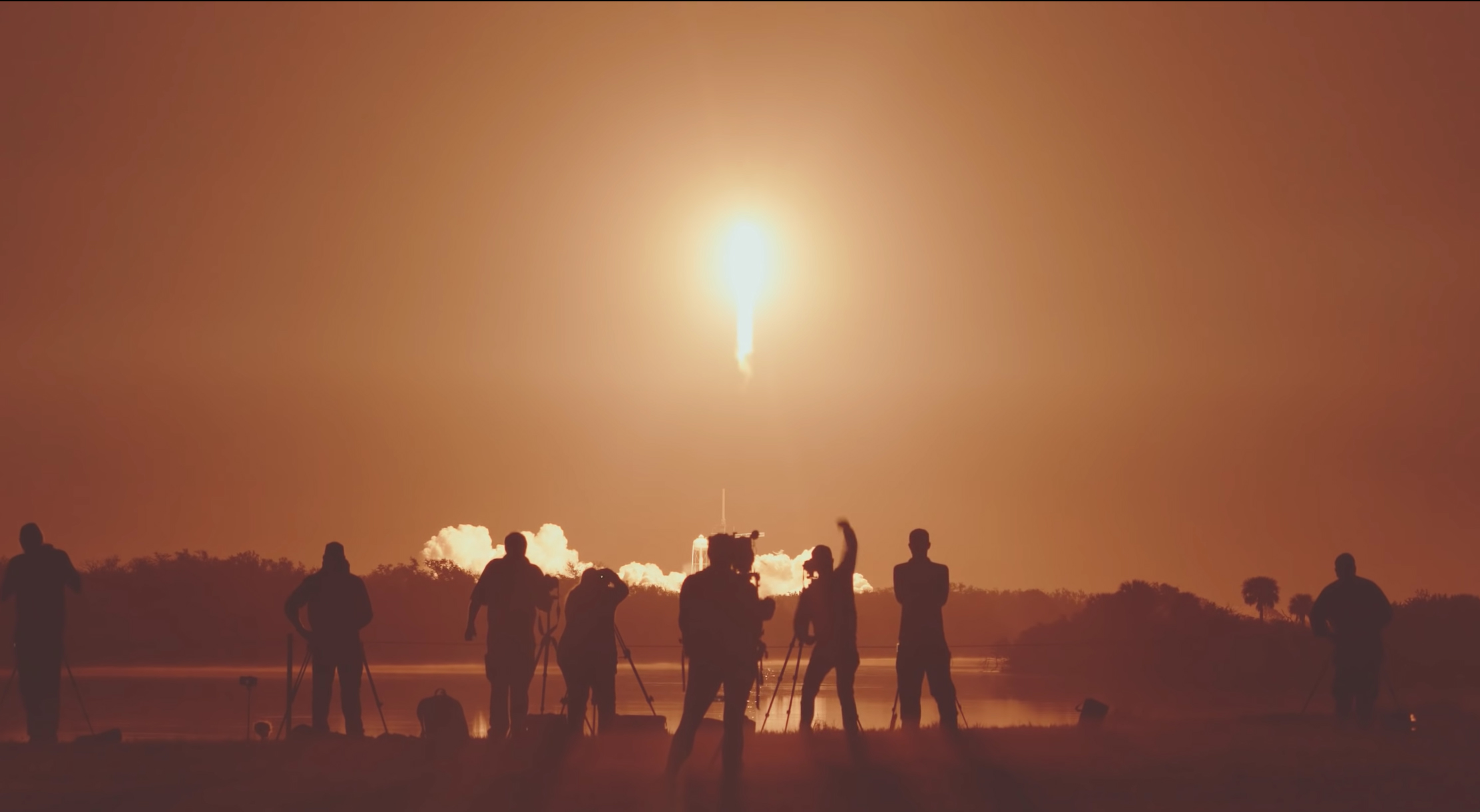 Image: Rocket launch photographers witness the Crew Dragon DM-1 mission launch on a Falcon 9 rocket from the press site at NASA Kennedy Space Center.