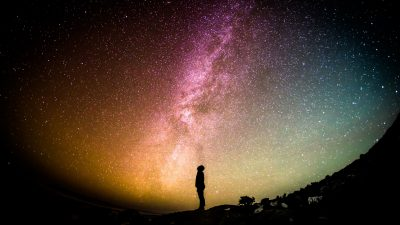 Image: Silhouette of a person looking up at the Milky Way