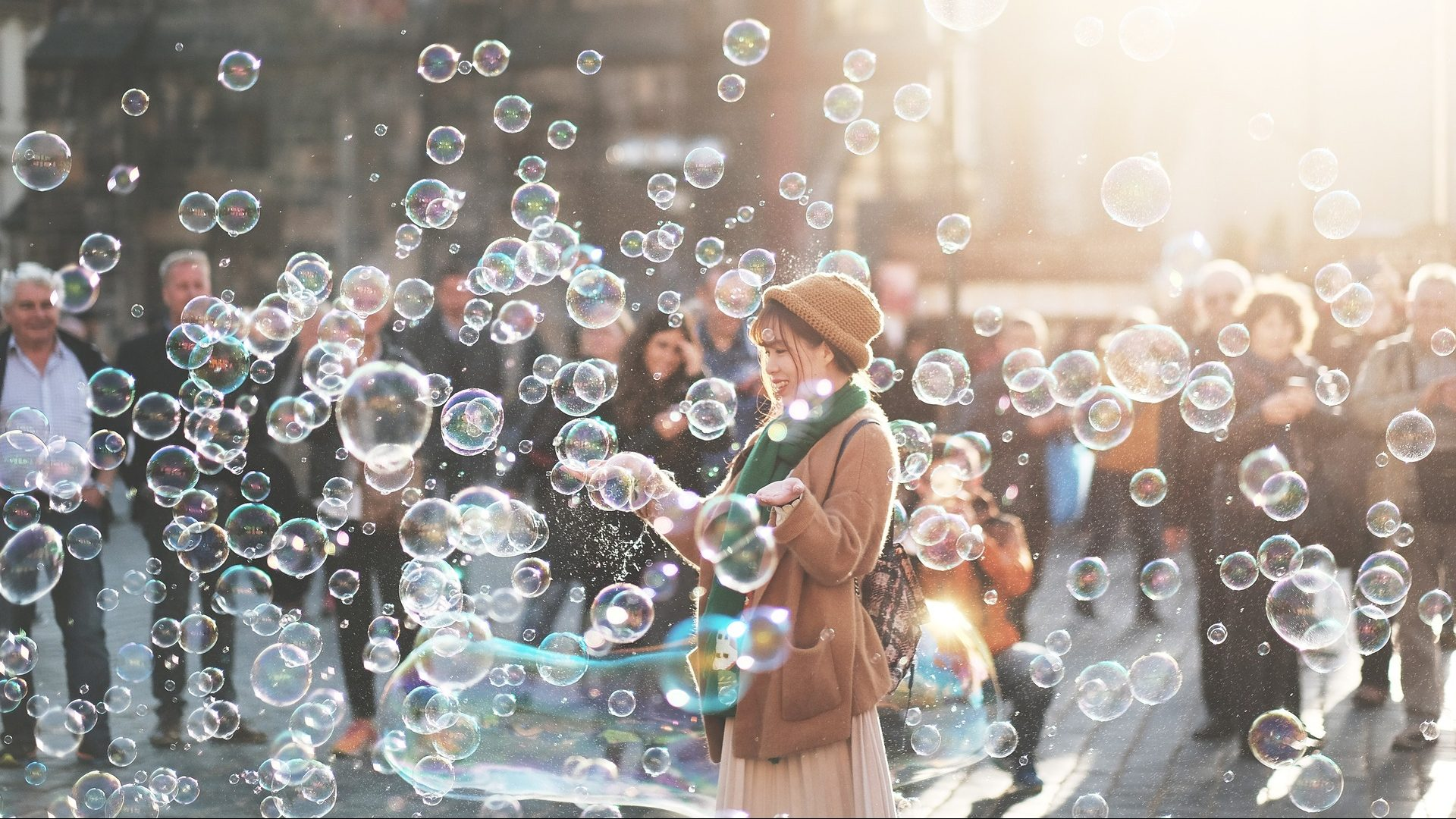 Image: a woman sanding in a cloud of bubbles
