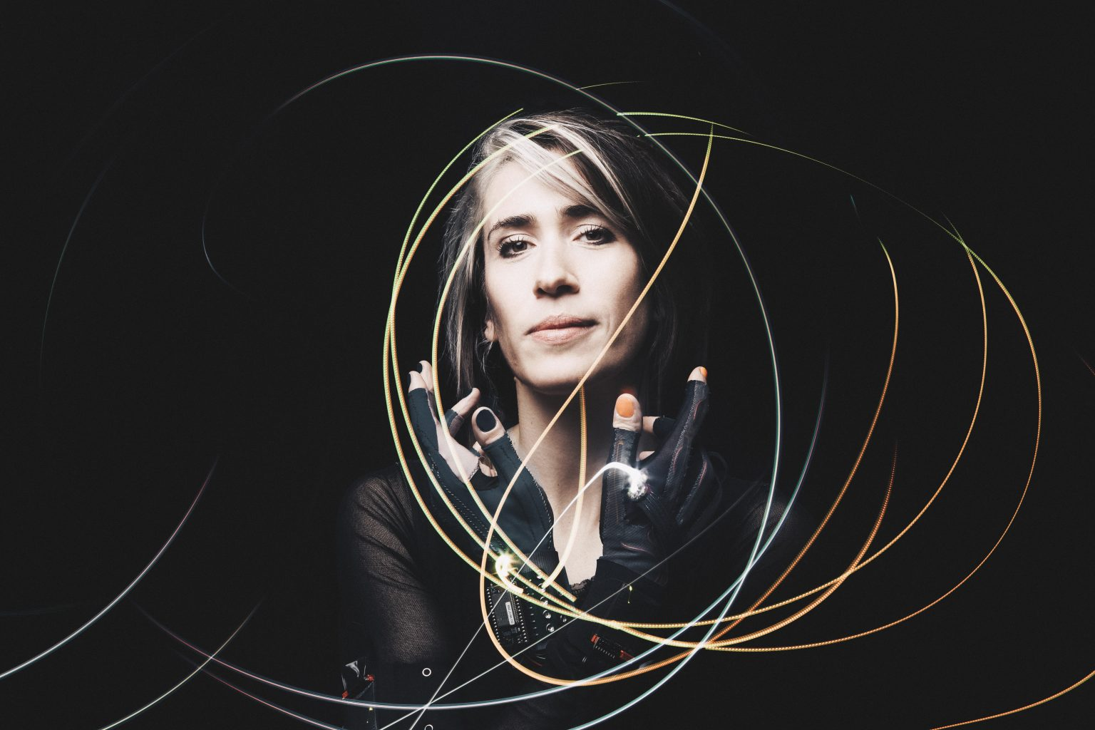 Image: Portrait of Imogen Heap modeling the Mi.Mu gloves