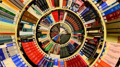 Image: Shelves of library books manipulated into concentric circles