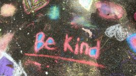 "Image: ""Be Kind"" written in chalk on a sidewalk"