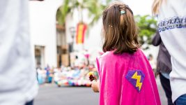 Image: Young girl wearing a pink cape