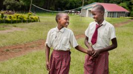 Image: Two smiling students from Kakenyas Center for Excellence!