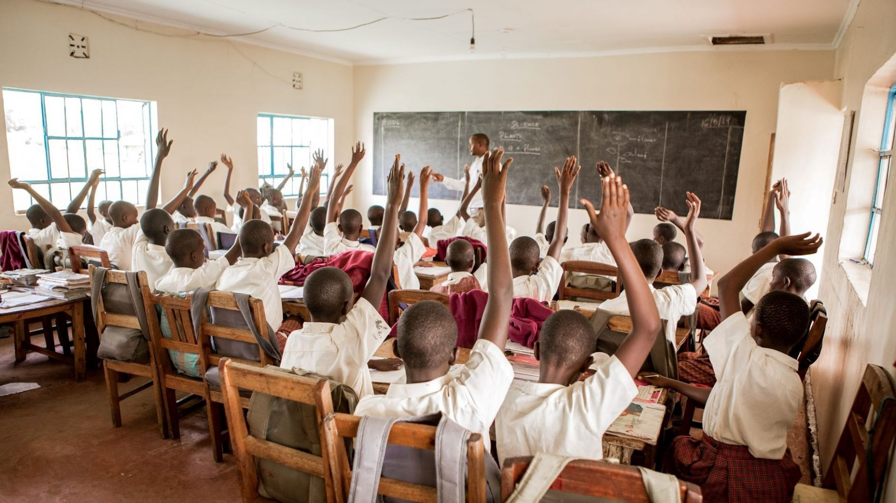 Image: Students raising hands in class!