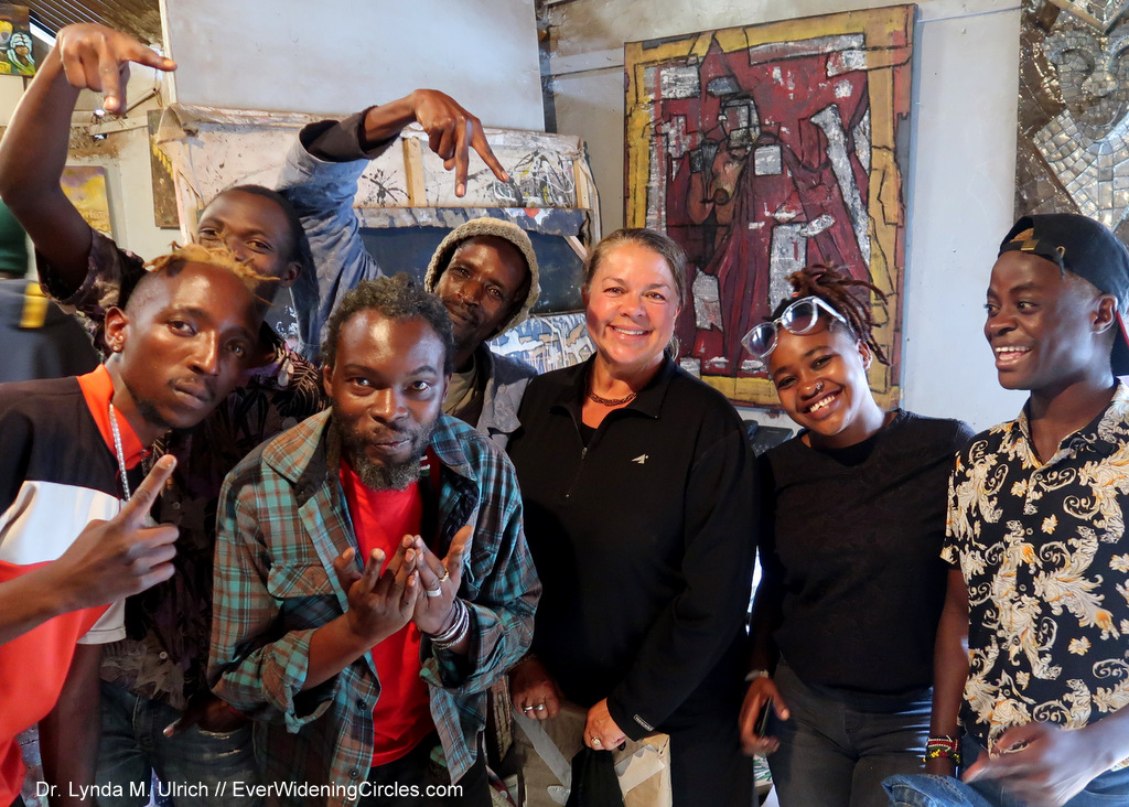 Image: Dr. Lynda with Artists in Kibera, the largest slum in Kenya after our interview with them about the good news in their area