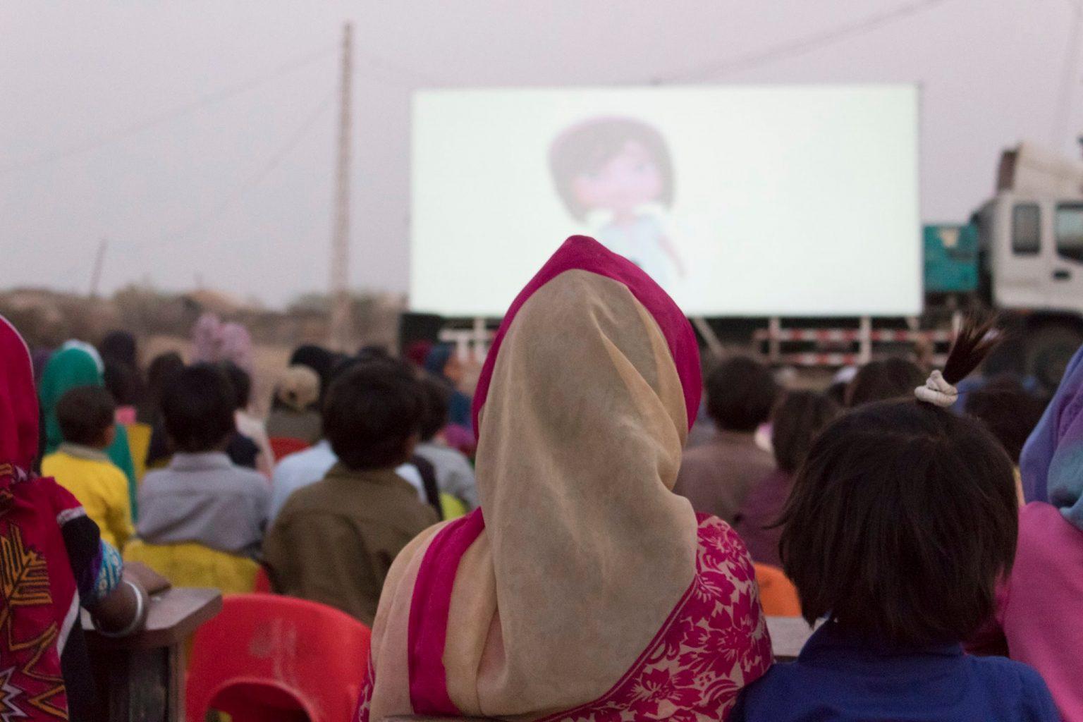 Image: People watching movie on mobile cinema