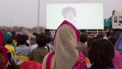 Image: People watching movie on mobile cinema