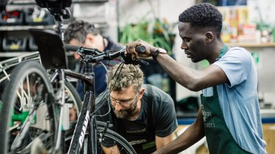 Image: Bristol Bike Project Members working on a bike together