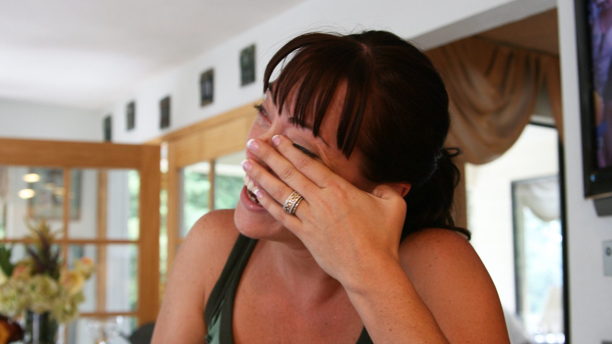 Image: Woman laughing and wiping her eyes