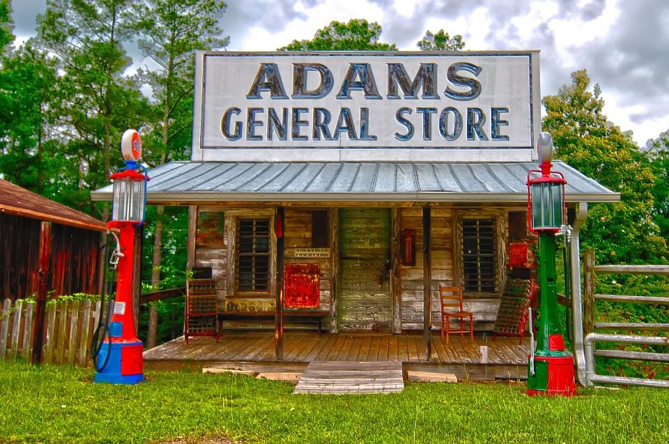 """Image: A small building with a large sign reading """"Adam's General Store"""""""